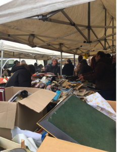 Dumped books crawled over by punters